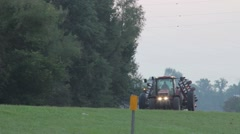 Large tractor on public highway in early morning Stock Footage