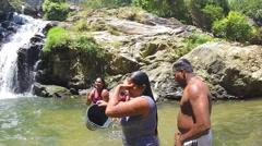 Local people bathing at Ravana waterfalls Stock Footage