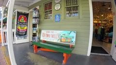 Old town trolley tours sign on bench in key west florida keys Stock Footage