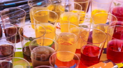 Coctails liquors alcohol beverage on plate Stock Footage
