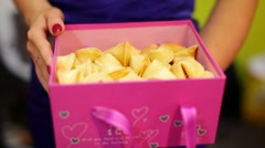 Fortune cookies in pink box Stock Footage