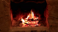 Flame in a fireplace with a dark background, Full HD Stock Footage