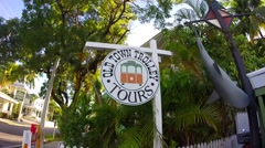 Old town trolley tours sign in key west florida keys Stock Footage