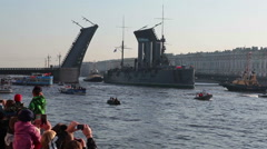 Cruiser Aurora passes through the opened Palace bridge on Neva river Stock Footage