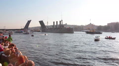 Stock Video Footage of Battleship Aurora passes through opened Palace bridge on Neva riv, St Petersburg