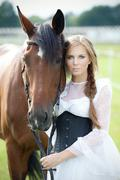 Beautiful smiling woman with horse chestnut - stock photo