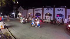 mopeds and scooters and bicycles at sloppy joes bar in key west florida keys - stock footage
