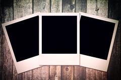 Gray wooden background with camera film Stock Photos