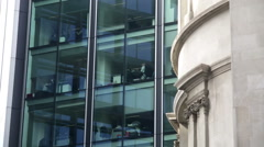 Modern London offices next to a traditional building Stock Footage