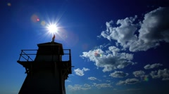Charlottetown Lighthouse, time lapse of sun going past light house Stock Footage