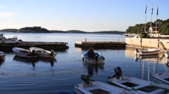Boat going to sea in Hvar island morning Stock Footage