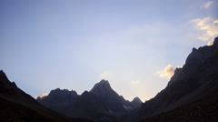 Moon illuminates the mountains. TimeLapse. Pamir Stock Footage