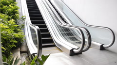 Escalators are shown that constantly run, which moves to basement floor Stock Footage