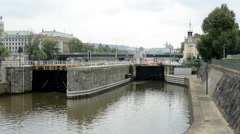 Lock for ships in the city - bridge with passing cars in background - Prague, Cz Stock Footage