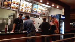 People ordering food inside kfc store Stock Footage