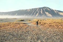 Boy exploring mountains area in Bali, Indonesia NTSC Stock Footage