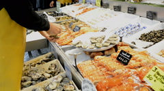 Seafood for sale in Trouville fish market in Normandy France Stock Footage