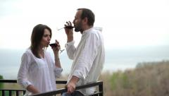 Stock Video Footage of young couple raising toast on terrace HD