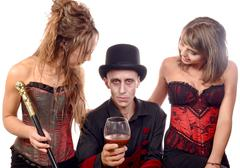 Two women and a man in disguise vampire Stock Photos