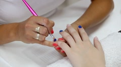 Beauty treatment of fingernails, painting lacquer Stock Footage