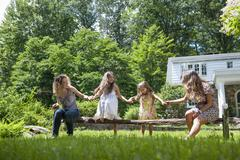 Family playing in the garden in summer. Stock Photos