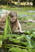 Girl playing outdoors. Stock Photos