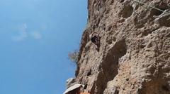 Rock Climber Climbing a Sheer Cliff at Malibu Creek State Park Stock Footage