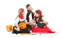 halloween: kids sharing halloween candy - stock photo