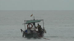 Fisherman putting nets out from a small fishing boat Stock Footage