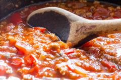 bolognese sauce is cooked in a pressure cooker - stock photo