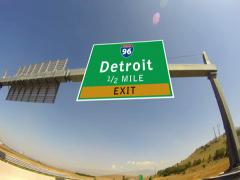 4k driving on highway/interstate,  exit sign of the city of detroit, michigan Stock Footage