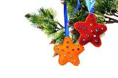 christmas decorations on a christmas tree star handmade fleece - stock photo