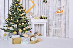 Christmas interior in white and gold color with christmas tree and gifts Stock Photos