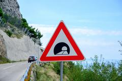 Road sign announcing a tunnel in the mountains Stock Photos