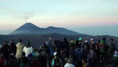 Crowd of people admire Mount Bromo volcano in Java, Indonesia HD Stock Footage