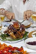 Composite image of close up of a man cutting a turkey for christmas dinner Stock Illustration