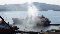 Air pollution. White cloud of smoke comes from ship in Gold horn bay Stock Footage