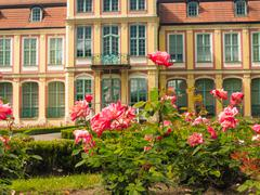 abbots palace and flowers in gdansk oliva park - stock photo
