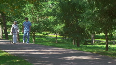 Beneficial Stroll for Senior Patient - stock footage