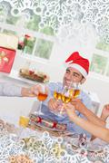 Family toasting at christmas dinner - stock illustration