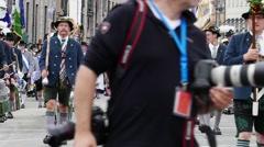 MUNICH BEER FESTIVAL OKTOBERFEST OCTOBERFEST 2014 Photographer shooting parade Stock Footage