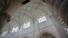 Slider shot along pillar in old church Stock Footage