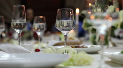 wineglasses with soda water on the festive table - stock footage