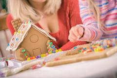 christmas: focus on candy and icing decorated gingerbread house - stock photo