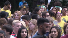 Diverse college and university students celebrating frosh week on campus Stock Footage