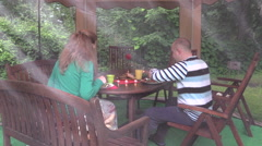 Happy couple eat barbeque food in bower. Romantic family supper Stock Footage