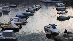 Fisherman sitting and resting by yacht marina in Dubrovnik Stock Footage