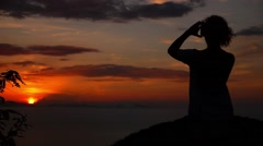 Woman Taking Pictures of Sunset. Slow Motion. Stock Footage