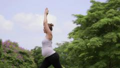 Pregnant woman, girl doing yoga, pregnancy, health, working out Stock Footage