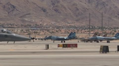 F-15 Eagle and F-22 Raptor stealth fighter at Red Flag Stock Footage